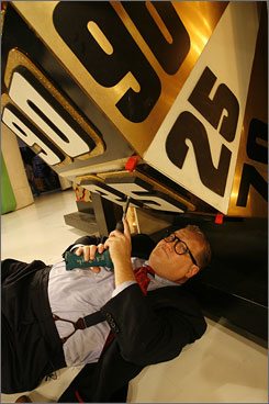 Just some minor adjustments: Drew Carey, pretending to fix the Showcase Showdown wheel, takes over as host of The Price Is Right next week. Retiring host Bob Barker gave Carey his blessing, and Carey isn't revamping the show.