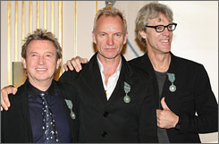 """Right now it is just the tour and holding everything together, mentally, physically and musically. The tour and the traveling and the playing and the tension you have to keep to do it every night is all-devouring,"" said Andy Summers, left, with bandmates Sting, center, and Stewart Copeland. ""It is just too much."""