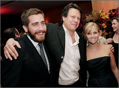 Rendition stars Jake Gyllenhaal, left, and Reese Witherspoon get chummy with director Gavin Hood at the film premiere's after party Wednsday in Beverly Hills, Calif. The movie opens October 19.