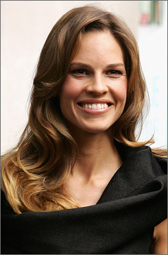 Hilary Swank: The actress, who is growing her hair long for charity, is the new face of Guerlain's Insolence perfume.