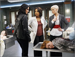 Crime solvers: Angie Harmon, left, Paula Newsome and Laura Harris are on the trail of a subway killer.