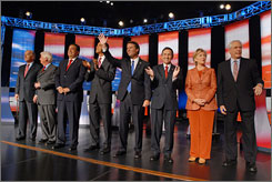 Clothes can make or break the man  or woman: Hillary Clinton stands out in a bright pantsuit next to her fellow Democratic presidential hopefuls. From left, Joe Biden, Chris Dodd, Bill Richardson, Barack Obama, John Edwards, Dennis Kucinich and Mike Gravel.