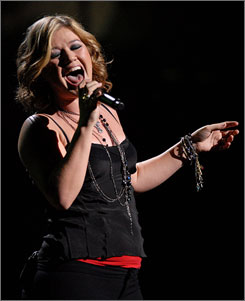 Because of you: Kelly Clarkson performed a mix of old and new tunes during Sunday's tour kickoff.