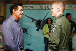Barry Williams talks with Air Force Capt. Don Haley before his honorary induction into the 335th Fighter Squadron at Seymour Johnson Air Force Base on Friday.
