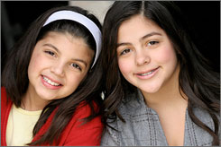 A slice of fame: Olivia, left, and Isabella Gerasole host a cooking webcast for kids that won a James Beard Foundation award. The sisters were the youngest winners ever.