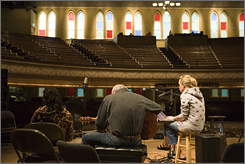 At the Ryman Auditorium: Carrie Underwood, right, worked with top Nashville songwriters, including Aimee Mayo, left, and Rivers Rutherford.
