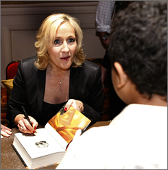 "Author J.K. Rowling signs copies of her book ""Harry Potter and the Deathly Hallows"" during the final stop on the ""J.K. Rowling Open Book Tour"" held at Carnegie Hall in New York City on Friday."