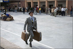 Enter Ghost?: Bill Murray runs for the Darjeeling Limited. Is he the spirit of the brothers' late (so to speak) father?