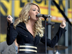 Carrie Underwood performs on Good Morning America on Tuesday. Underwood, Beyonce and Elton John will perform at the first-ever Movies Rock concert in Los Angeles on Dec. 2.