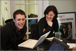 Funny job: Bryan Safi and Amy Rhodes generate ideas during a staff meeting at FunnyorDie.com, which had a huge hit with Will Ferrell's The Landlord video