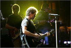 Back home in New Jersey: Jon Bon Jovi rehearses with his band in downtown Newark's new Prudential Arena.