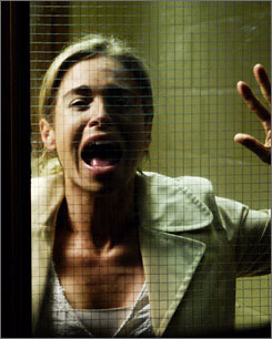 It's a scream: Betsy Russell awaits her fate in Saw IV.
