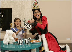 Dressed up for the season: Teri Hatcher is the Queen of Hearts and her daughter, Emerson, is Alice in Wonderland.