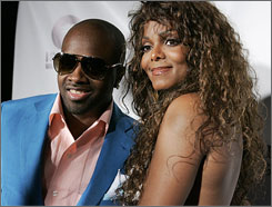 Mixing business with pleasure: Jermaine Dupri worked on girlfriend Janet Jackson's album 20 Y.O.