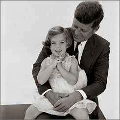 Father and daughter: President John F. Kennedy holds Caroline in The Kennedys: Portrait of a Family, with photos by Richard Avedon.