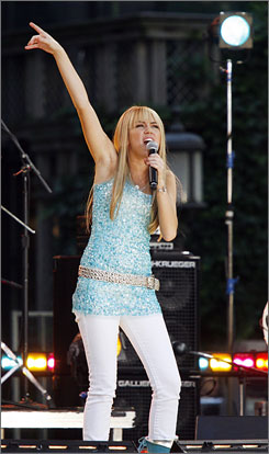 Hot ticket: Miley Cyrus performs on ABC's Good Morning America Summer Concert Series in New York in June. Her sold-out Miley Cyrus/Hannah Montana Best of Both Worlds tour opened in St. Louis last month. Some parents went to great lengths for seats.