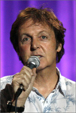 Paul McCartney  has been photographed kissing another woman in the Hamptons.