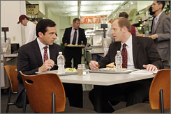 At The Office: Steve Carell, left, stars as Michael Scott, who loves to insult Toby Flenderson, played by Paul Lieberstein. Next week's episode could be it for a while: Carell is a Writers Guild member.