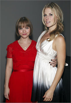 Perfume party: Christina Ricci, left, and Ali Larter help launch the DKNY Delicious Night fragrance.