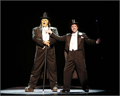 It can sing!: The Monster (Shuler Hensley, left) gets musical with his creator, Dr. Frederick Frankenstein (Roger Bart).