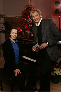 """Season for change: Barry Manilow, with pianist Matt Herskowitz, has a new album,  In the Swing of Christmas. Now, he's writing a more """"gritty,"""" rock-oriented album."""