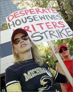 "Help from one of the Housewives: Felicity Huffman joins writers on the picket line in Universal City, Calif.  ""God willing, we have a strong enough show that no matter how long the strike goes, we'll come back."""
