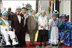 Surviving residents of Munchkinland enjoy their induction into the Hollywood Walk of Fame on Tuesday. From left: Clarence Swensen, Mickey Carroll, Jerry Maren, Karl Slover, Ruth Duccini, Margaret Pellegrini and Meinhardt Raabe