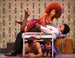 Bathhouse banter: Rosie Perez climbs on top of Kevin Chamberlin, as Terrence Riordan, left, and Brooks Ashmanskas hide under the bed in The Ritz.