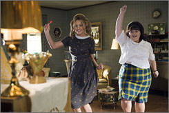 Silliness: Dancing fools Amanda Bynes, left, and Nikki Blonsky in Hairspray.