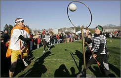 Magic moment: Ben Weir, left, scores for the Wild Fire Whiz Bangs as Prisoners of Azkaban's Christian Woodland, right, watches the hoop during the Middlebury Quidditch World Cup tournament. Earthbound versions of the high-flying game created by J.K. Rowling are being played at colleges.