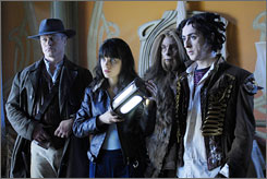 "Off to O.Z.: Neal McDonough, left, Zooey Deschanel, Raoul Trujillo and Alan Cumming in the ""Outer Zone."""