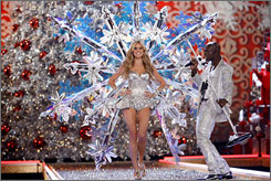 Star couple: Heidi Klum walks the runway as husband Seal performs at the Victoria's Secret Fashion Show.