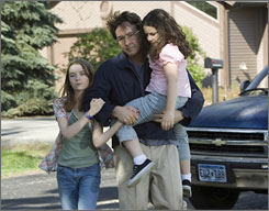 John Cusack with Shelan OKeefe, left, and Grace Bednarczyk in a scene from Grace Is Gone.