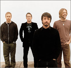 Fighting their way into Grammy territory: Nate Mendel, left, Chris Shiflett, Dave Grohl and Taylor Hawkins of the Foo Fighters will compete in five categories, including album and record of the year.