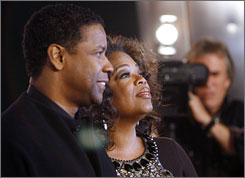 Oprah Winfrey and Denzel Washington at the premiere of The Great Debaters on Tuesday.