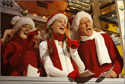 In Hollywood: Jenni Mickelson, left, Deborah Mickelson and John Hostetter sing as the Magical Christmas Caroling Truck makes its rounds.
