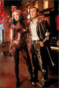 Soon to become a reality?: Jude Law, right, with Ashley Scott, played a robot gigolo in the 2001 film A.I.: Artificial Intelligence.