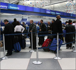 Seasonal hassle: Weather delays this month forced travelers to wait in long ticketing lines at Chicago's O'Hare International Airport.
