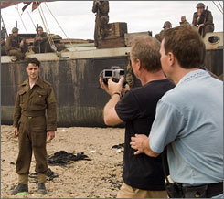 Atonement cinematographer Seamus McGarvey, right, guides James McAvoy through the complex tracking shot scene.