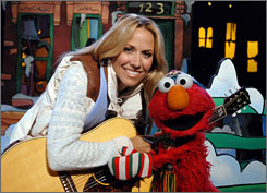 See you at 7 on Sunday: Sheryl Crow is among the stars who join Elmo for his ABC special, in which the Christmas countdown numbers 1-10 become lost.