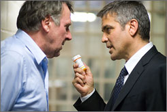 Laying down the law: Tom Wilkinson, left, and George Clooney are both nominated for Golden Globe Awards and Screen Actors Guild Awards for their roles in Michael Clayton.