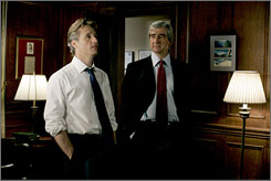 Fresh blood, new job: Linus Roache, left, joins Sam Waterston as a prosecutor.