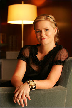 Here, there: Cecelia Ahern, 26, who lives in Dublin, takes a breather at the Le Parker Meridien in New York.
