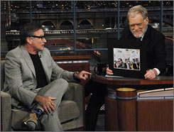 "David Letterman let striking writers supply the jokes for his venerable top 10 list. Guest Robin Williams supplied the cracks about the late-night host's new ""strike beard."""