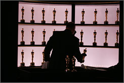 At the ready: Steve Miessner prepared Oscar statuettes in the Kodak Theatre for last year's Academy Awards. This year marks the 80th salute to Hollywood's finest.