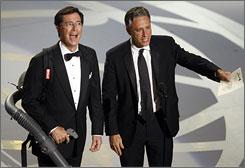 Stephen Colbert, left, and Jon Stewart present an award at the Emmys last fall.