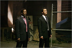 Urban intrigue in Baltimore: Clarke Peters, left, and Dominic West.
