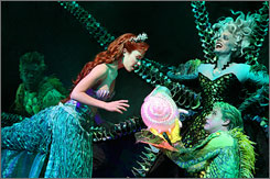 Evil exchange: Jetsam (Derrick Baskin, left) and Flotsam (Tyler Maynard, front) help sea witch Ursula (Sherie Rene Scott, right) steal Ariel's (Sierra Boggess) voice, which the mermaid trades for legs to replace her fin. To simulate underwater movement, cast members glide around on Heelys, or sneakers with embedded wheels that act like skates.