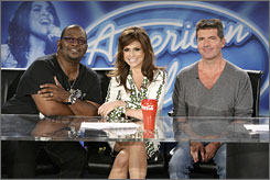 "They're back: Judges Randy Jackson, left, Paula Abdul and Simon Cowell are ""as childish as ever"" in American  Idol's seventh year, executive producer Nigel Lythgoe says. The show returns Tuesday (8 p.m. ET/PT) on Fox."