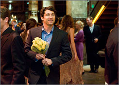 Made of Honor: Patrick Dempsey comes with flowers in hand.